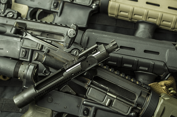 A stack of AR-15 carbines used in the brass vs. steel testing.