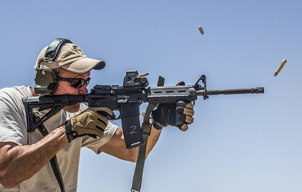 A man firing an AR-15 with Federal brass cased ammunition.